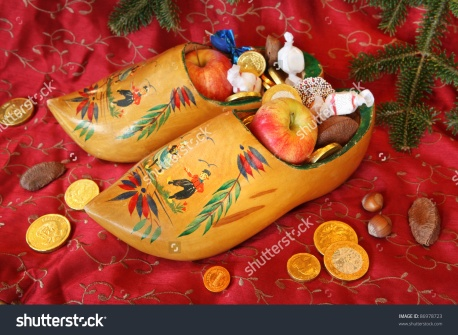 stock-photo-vintage-wooden-shoes-filled-with-treats-for-st-nicholas-day-86978723